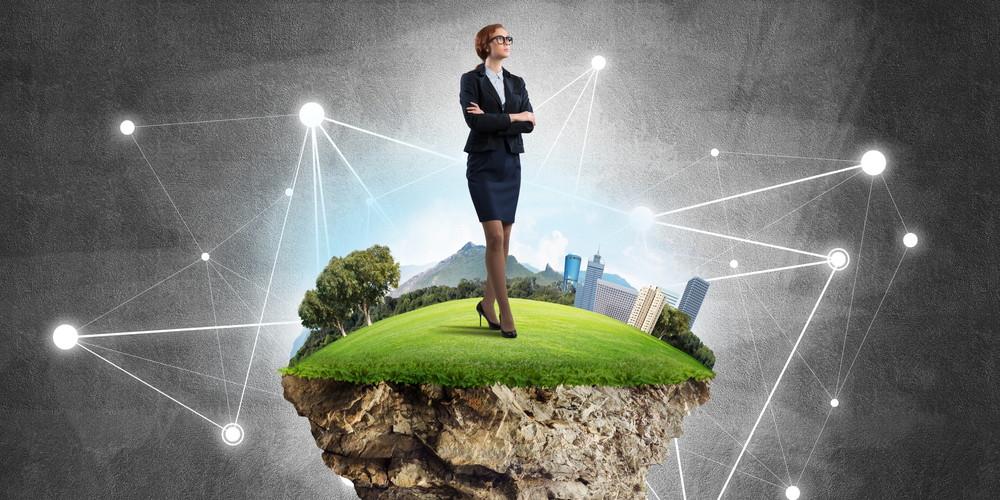 Elegant businesswoman on flying green island against concrete background
